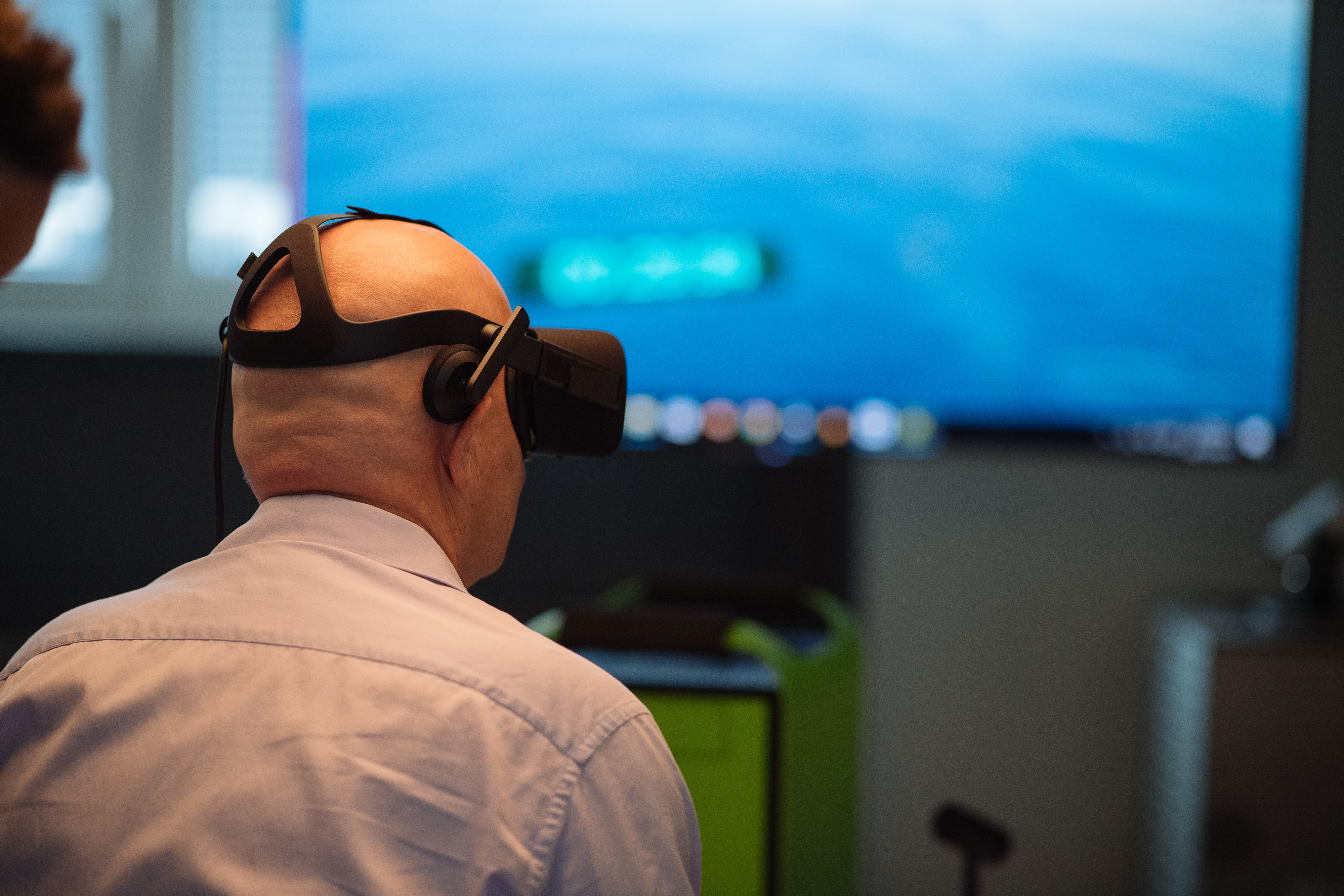 A person testing VR and the Limbic Chair