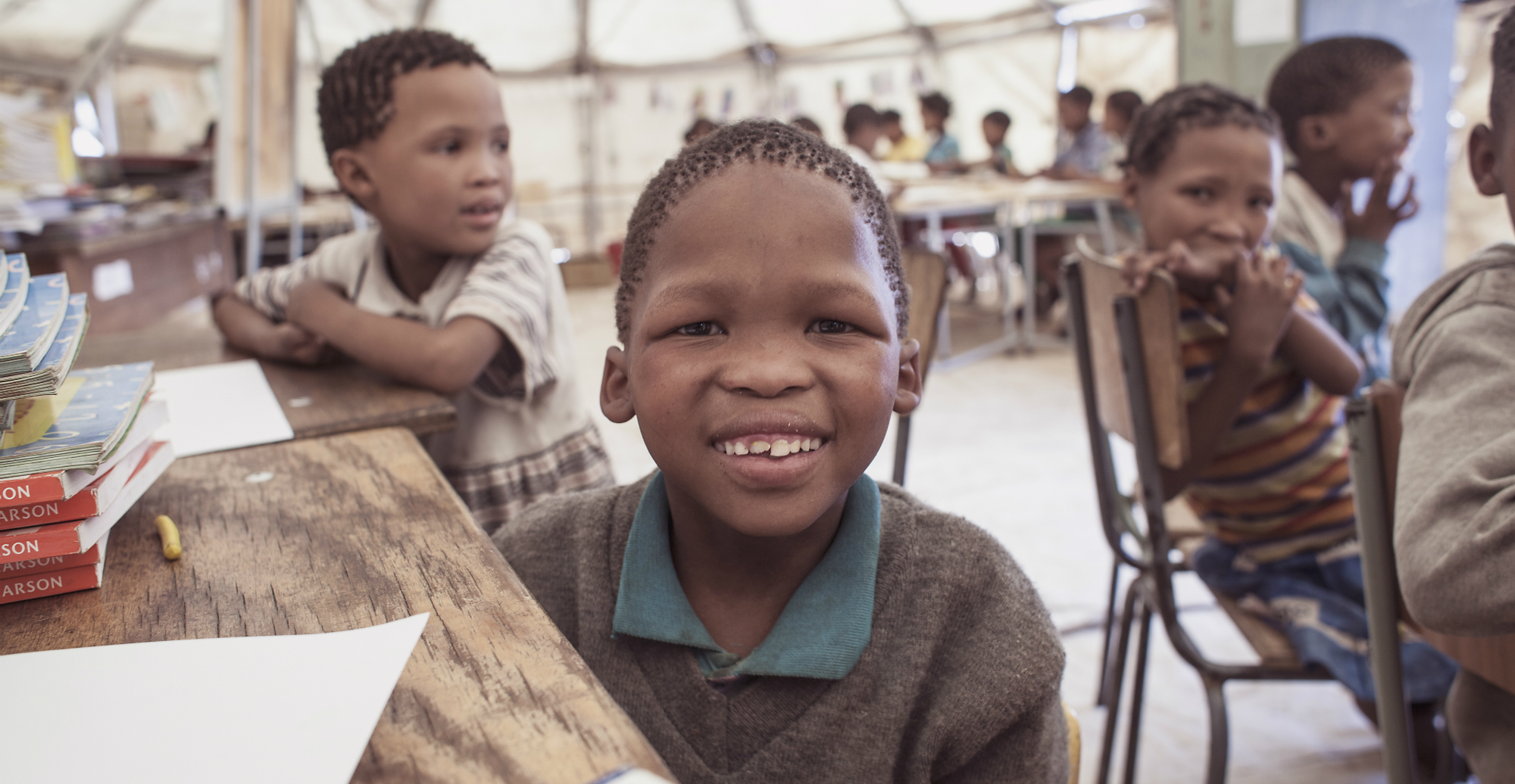 Young boy smiling in classroom