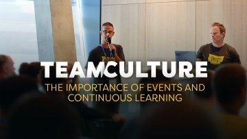 Team Culture. The Importance of Events and Continuous Learning. Fran and Stew presenting a talk at Drupal Europe in Darmstadt.